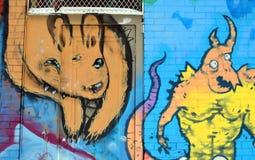 ζωηρόχρωμος καλυμμένος τοίχος οδών γκράφιτι τέχνης Στοκ εικόνες με δικαίωμα ελεύθερης χρήσης