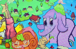 ζωηρόχρωμος καλυμμένος τοίχος οδών γκράφιτι τέχνης Στοκ Φωτογραφία