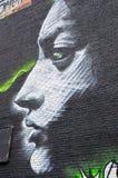 ζωηρόχρωμος καλυμμένος τοίχος οδών γκράφιτι τέχνης Στοκ εικόνα με δικαίωμα ελεύθερης χρήσης