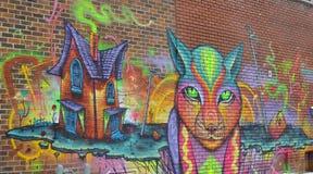 ζωηρόχρωμος καλυμμένος τοίχος οδών γκράφιτι τέχνης Στοκ φωτογραφία με δικαίωμα ελεύθερης χρήσης