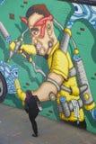 ζωηρόχρωμος καλυμμένος τοίχος οδών γκράφιτι τέχνης Στοκ Εικόνες
