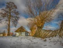 Ζωηρόχρωμος χειμώνας σπιτιών κούτσουρων Στοκ Εικόνα