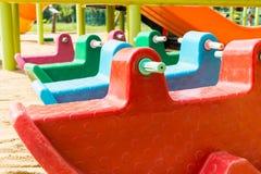 Ζωηρόχρωμο αυτοκίνητο παιχνιδιών στην παιδική χαρά Στοκ εικόνες με δικαίωμα ελεύθερης χρήσης