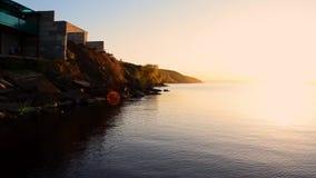 Ζωηρόχρωμο ηλιοβασίλεμα στον άνευ ραφής βρόχο θάλασσας απόθεμα βίντεο