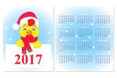 Ζωηρόχρωμο ημερολόγιο 2017 με έναν κόκκορα σε ένα καπέλο και ένα μαντίλι Άγιου Βασίλη διανυσματική απεικόνιση