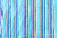 Ζωηρόχρωμο διαμορφωμένο γραμμή υπόβαθρο σύστασης υφασμάτων Στοκ Φωτογραφίες