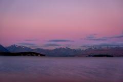Ζωηρόχρωμο ονειροπόλο τοπίο της λίμνης Tekapo στο ηλιοβασίλεμα, Νέα Ζηλανδία Στοκ Φωτογραφία