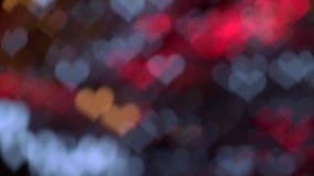 Ζωηρόχρωμο πολύχρωμο υπόβαθρο κινήσεων φω'των διαμορφωμένο καρδιά bokeh απόθεμα βίντεο