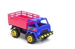 Ζωηρόχρωμο φορτηγό παιχνιδιών στο άσπρο υπόβαθρο Στοκ Εικόνες