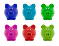 ζωηρόχρωμο piggy σύνολο τραπε Στοκ Φωτογραφία