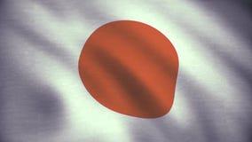 Ζωτικότητα σημαιών χώρας της Ιαπωνίας Ζωτικότητα σημαιών χώρας της Ιαπωνίας που κυματίζει στην κινηματογράφηση σε πρώτο πλάνο αερ απεικόνιση αποθεμάτων