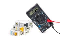 Ηλεκτρικός μορφωματικός διακόπτης και ψηφιακό πολύμετρο Στοκ Εικόνα