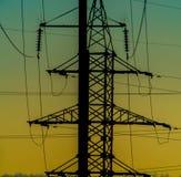 Ηλεκτρικός πόλος, μπλε κίτρινος ουρανός Στοκ Εικόνες