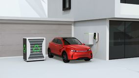 Ηλεκτρικό όχημα που επαναφορτίζει στο γκαράζ Σταθμός φόρτισης που τροφοδοτείται από τις επαναχρησιμοποιημένες μπαταρίες της EV ελεύθερη απεικόνιση δικαιώματος