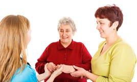 Ηλικιωμένη γυναίκα με το φροντιστή και το νέο γιατρό στοκ φωτογραφία με δικαίωμα ελεύθερης χρήσης