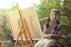 Ηλικιωμένη ζωγραφική ατόμων σε έναν καμβά Στοκ Φωτογραφία