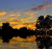 ηλιοβασίλεμα αντανακλά&s Στοκ Φωτογραφίες