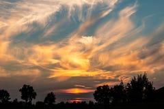Ηλιοβασίλεμα και σύννεφα Στοκ Εικόνες