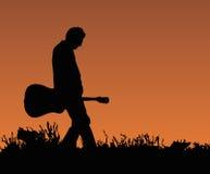 ηλιοβασίλεμα κιθαριστώ& στοκ φωτογραφία