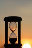 ηλιοβασίλεμα κλεψυδρώ& Στοκ Φωτογραφία