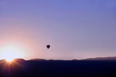 ηλιοβασίλεμα μπαλονιών &alp Στοκ Εικόνα