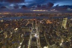 Ηλιοβασίλεμα πέρα από την πόλη του Μανχάτταν - της Νέας Υόρκης με Hudson Στοκ Εικόνες