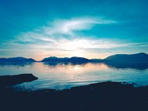 Ηλιοβασίλεμα πέρα από τη λίμνη Glencoe στοκ εικόνες με δικαίωμα ελεύθερης χρήσης