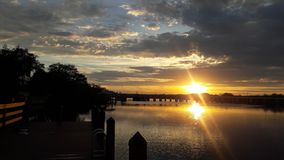 Ηλιοβασίλεμα, ποταμός φοινικών Στοκ Εικόνες