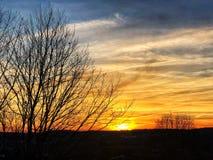 Ηλιοβασίλεμα που καίγεται στον ορίζοντα Στοκ Εικόνα