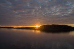 Ηλιοβασίλεμα στην ακτή Στοκ Εικόνα