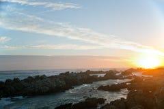 Ηλιοβασίλεμα στο ακρωτήριο Agulhas στη Νότια Αφρική Στοκ Φωτογραφίες