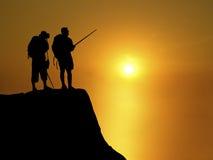 ηλιοβασίλεμα backpackers Στοκ Φωτογραφίες
