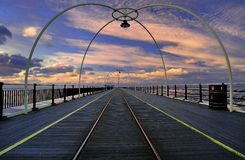 ηλιοβασίλεμα UK αποβαθρώ&nu Στοκ Φωτογραφίες