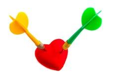 Ημέρα βαλεντίνων. Κόκκινο σύμβολο αγάπης καρδιών με δύο βέλη. Ανταγωνισμός. Στοκ Εικόνες