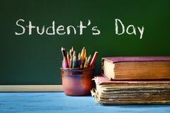 Ημέρα σπουδαστών κειμένων σε έναν πίνακα κιμωλίας Στοκ Εικόνα