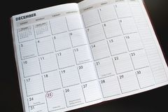 Ημερολογιακό υπόβαθρο Δεκεμβρίου με το 25ο κύκλο Στοκ Εικόνα