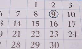 Ημερομηνία σε έναν μαύρο κύκλο στο ημερολόγιο Στοκ Φωτογραφίες