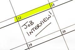 'Ημερομηνία' συνέντευξης εργασίας σε ένα ημερολόγιο στοκ εικόνες