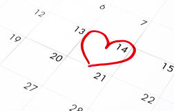 'Ημερομηνία' της 14ης Φεβρουαρίου στο ημερολόγιο, κόκκινη καρδιά ημέρας του βαλεντίνου που περικυκλώνεται Στοκ Εικόνες