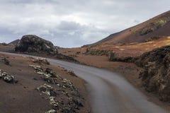 Ηφαιστειακό σεληνιακό τοπίο στο εθνικό πάρκο Timanfaya Στοκ Φωτογραφίες
