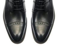 Η άκρη των αρσενικών παπουτσιών που απομονώνεται στο λευκό Στοκ φωτογραφία με δικαίωμα ελεύθερης χρήσης