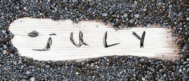 Η άμμος επάνω το ξύλο - Ιούλιος Στοκ φωτογραφία με δικαίωμα ελεύθερης χρήσης