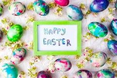 Η άνοιξη καρτών αυγών Πάσχας ανθίζει το υπόβαθρο Στοκ Εικόνες