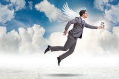 Η έννοια επενδυτών αγγέλου με τον επιχειρηματία με τα φτερά Στοκ εικόνες με δικαίωμα ελεύθερης χρήσης