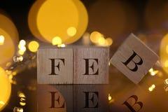 Η έννοια μήνα, μπροστινή άποψη παρουσιάζει ξύλινο γραπτό φραγμός FEB με το λι Στοκ εικόνες με δικαίωμα ελεύθερης χρήσης