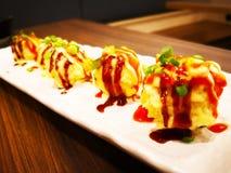 Η έννοια τροφίμων, Takoyaki είναι ένα ιαπωνικό πρόχειρο φαγητό με μορφή του littl Στοκ φωτογραφία με δικαίωμα ελεύθερης χρήσης