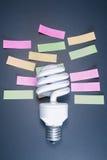 Η έννοια υπενθυμίζει στην ηλεκτρική ενέργεια, λάμπες φωτός - εικόνα αποθεμάτων Στοκ Φωτογραφία