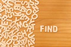 Η λέξη βρίσκει γίνοντας με τις ξύλινες επιστολές φραγμών στοκ εικόνα
