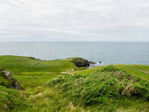 Η λέξη Ιρλανδία έκανε με τις πέτρες στους τομείς στην ακτή του MAG Στοκ φωτογραφίες με δικαίωμα ελεύθερης χρήσης