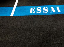 Η λέξη ESSAI που χρωματίζεται στην άσφαλτο Στοκ Φωτογραφίες